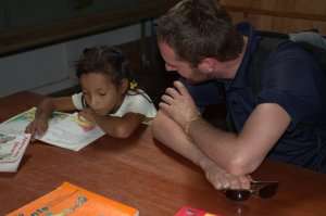 Matt listening to child read