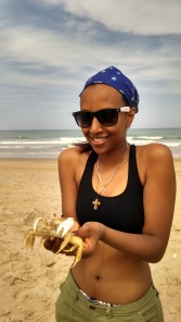 Life at the end of the tunnel-- Mera learned how to hold a crab for the first time! These ghost crabs are responsible for the countless half-dollar-sized holes we found on the beach.