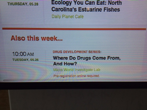Museum board advertising the Drug Development series in the Micro World iLab.